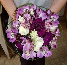 Purple Alstroemeria and Carnations with White Mini Roses and a Lily Grass Collar