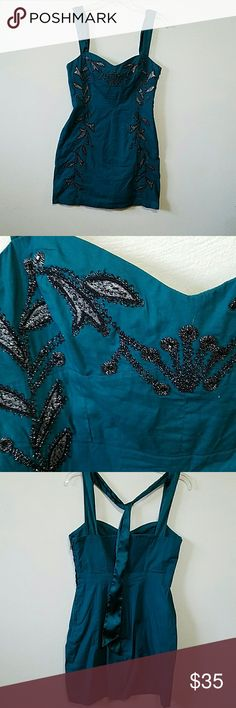 FREE PEOPLE  dress Darling turquoise dress with black and metalic silver application and embroidery.   In excellent condition. Free People Dresses Mini