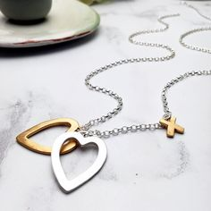Because 2 are always better than 1  . . . #heartnecklace #2hearts #smallbusinessowner #valentinesgiftideas #personalisedjewellery #goldplatedjewelery #giftforher #madebyme #bespoke #jewellerydesigner #jewelrygram