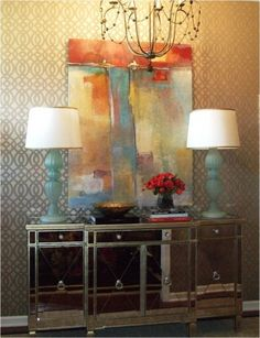 mirrored chest entryway | Love Tobi Fairley's modern entry with mirrored chest and abstract art