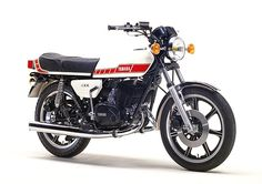 Yamaha RD 400. Had one of these, race tuned when I was 17. Kept trying to throw me at the scenery. Until it put me through a hedge @ 70mph. Great bike though.