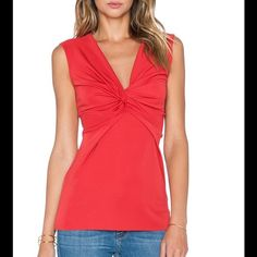 Sold Bailey 44 Roller Skating Top This is an absolutely striking top in red with a V-neckline and knot front detail. The style is such a flattering fit. The size large fits a size 8-10. Fabric: Modal blend of 94% polyester/6% spandex Dry clean Anthropologie Tops