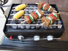 Getting fancy with the kebabs and corn.  From: 35 Impressive Cakes Shaped Like Grills For Father's Day
