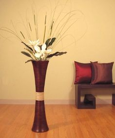 32 in.Tall Trumpet Bamboo Brown Vase & Magnolias by Shopping The Globe. $64.90. This is an all natural, renewable resources product. Floral arrangment kit requires assembly, easy step by step instructions with pictures included. For arrangement with earthtone Oceana Palms add $9.95. For white Magnolias & Cattails add $14.95. You can purchase the Vase Only on Super Sale, or the vase with your choice of floral arrangement. Fluted, tall vase handcrafted from natural bamboo is 32...