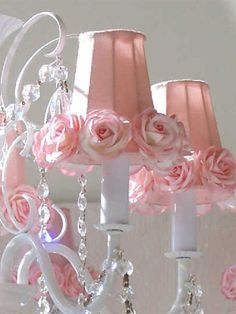 The cutest chandelier ever - I love the pink and the roses.