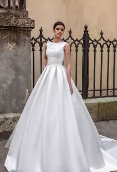 Classic modest bateau neckline ballgown wedding dress; Featured Dress: TM Crystal Design
