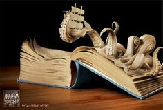 bookart. What a neat idea. Taking something like a storybook and making the story come to life. The detailing of the octopus is very good. Wonder if this person got a couple paper cuts making this!