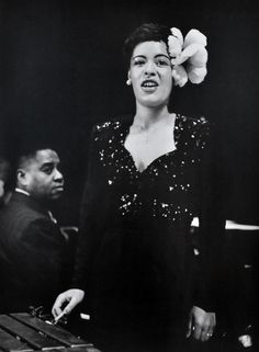 1944 photo of Billie Holiday on stage at the Metropolitan Opera House. Art Tatum on piano