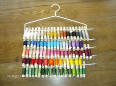 **2012**Clothespin Embroidery Floss Organization on pants hanger..The clothespin are in no way my original idea. It's great! but I couldn't stand sifting through a basket looking for the color I needed and I marked the pin with the floss number