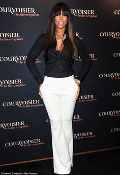 Monochrome maiden: The 32-year-old singer teamed her black shirt with a pair of white trousers for the drinks bash in New York