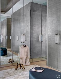 In a London home decorated by Francis Sultana, the master bedroom's closet, customized by Sultana, has palladium-leaf doors; the carpet is by Fort Street Studio.