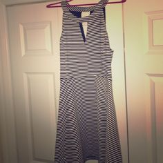 1d3daf08fe9 Shop Women s Express Black White size L Midi at a discounted price at  Poshmark. Description  Black and white striped express dress. Very  comfortable and fun ...