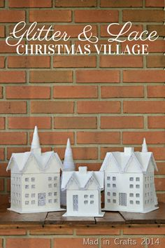 Spray paint, glitter, and lace turn paper mache houses into a pretty Christmas village. Christmas Village Houses, Putz Houses, Christmas Villages, Christmas Home, Mini Houses, Holiday Crafts, Home Crafts, Holiday Decor, House Template