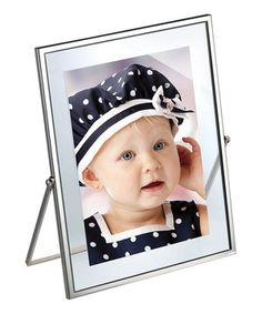 With a simple easel-back and glass backing that gives a cool 'floating' look to photos, this frame is great for any room. Easily display precious memories for the world to see.