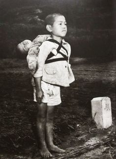 Nagasaki, 1945 ( a young boy carrying his dead little brother)