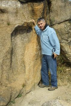 This is the infamous giant footprint found in South Africa. It is approximately 5' tall and it's embedded in granite! It's estimated to be 200 Million years old. Wow.: