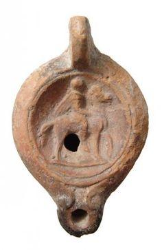 An Orange-ware Roman Oil Lamp, C. 2nd - 3rd Century AD