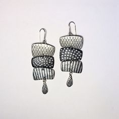 """Measurements: 1"""" x 3"""" Materials: Polymer Clay, Silver"""