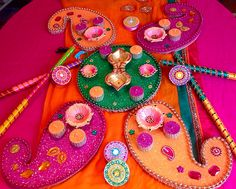 Hand made mehndi plates in gorgeous pink orange and green. See my facebook page www.facebook.com/mehnditraysforfun for more ideas and inspiration