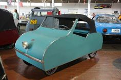 Ardex Microcar (1953). Due to hard economic times, some were made of wood or aluminum, depending on what material was available. The car was about as simple as could be, with bicycle tires and one door to reduce construction costs. Sales were very low.