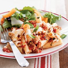 This easy, cheesy pasta recipe features ziti, turkey sausage, canned tomatoes, and fresh basil. It's a perfect pasta dish for busy...