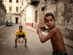 Cuban kid, love this!! It shows how different cultures cross boundaries.  Baseball the great American pass time.  Yet, there are many professional Cubans in the sport today.
