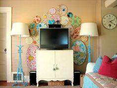 Decorate Your TV Wall - Home Decorating Ideas - Good Housekeeping --- Go Bold With Color - Fabric scraps from projects past find a new home in an eye-catching mural of fun hoops.