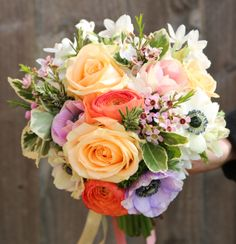 Bright spring pastels of ranunculus, anemone, avalanche rose and paperwhites.  Floral styling by Glorious Twelve www.glorioustwelve.com