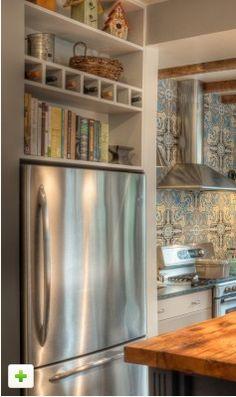 wine and cookbooks above fridge