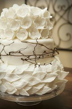 white leaves and branches tiered cake--like the bottom two, not a huge fan of the top one.