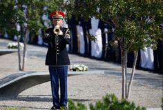 An honor guard plays Taps at the Pentagon Memorial as the 10th anniversary of the September 11 attacks are observed at the Pentagon in Washington.