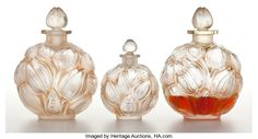 , FROM THE ESTATE OF SHIRLEY JACOBS ALTER. R. LALIQUE. Three perfumebottles for 'Bouquet' by Jay Thorpe, all with sepia pat... (Total:3 Items)
