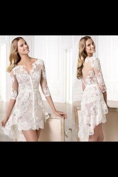 Loving this cream colored short lace wedding dress