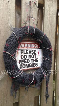 Made to order wreath, actual wreath will vary from pictures.  16 black yarn wreath. Covered in grey mesh cloth, torn and ripped for effect. Fake