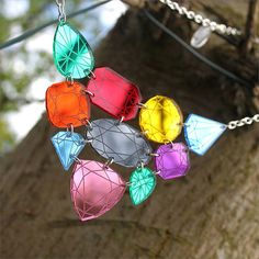 """This #necklace consists of 10 different coloured gemstone charms engraved and cut from mirror acrylic. They are interlinked and measure approximately 95mm at the widest point and hang from a chunky 16"""" plated chain"""