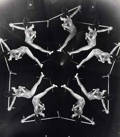 Weegee (Arthur Fellig, 1899-1968) - Acrobats/distortion, 1950. S)
