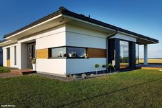 Dom w bodziszkach House Plans, Garage Doors, Exterior, House Design, Zimbabwe, How To Plan, Architecture, Bungalow, Outdoor Decor