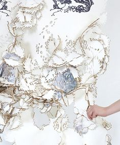 Laser cut textiles with modular pieces used to create sustainable clothing & wall coverings; fabric manipulation // Eunsuk Hur