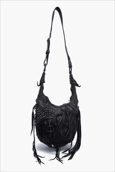 I keep trying to turn my bags into this. Love the textures and dangly bits.