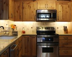 Furniture Interesting Craftsman Kitchen With Pine Kitchen Cabinets Also Stainless Cooker And Microwave Oven Also
