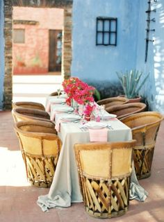 Vintage chairs, blue stucco, bougainvillea