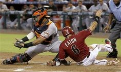 Arizona Diamondbacks' Adam Eaton (6) scores ahead of the tag by San Francisco Giants' Hector Sanchez in the first inning of a baseball game on Sunday, Sept. 1, 2013, in Phoenix. (AP Photo/Ross D. Franklin)