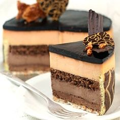 Peanut Butter - Chocolate Entremet !!!  Peanut butter and milk chocolate 'everything' wrapped in a joconde imprime. Crispy, creamy, crunchy, 'moussey' - pure decadence.