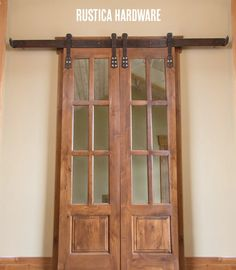 I don'know if i'm way behind the decorating curve -  but I am totally loving this trend of great rustic interior barn doors, hung on fabulous hardware.  http://RusticaHardware.com/