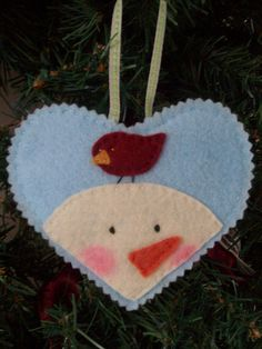 I am loving all the felt ornaments I'm seeing. I am definitely going to try my hand at a few . . . This one's very cute.