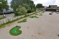 Mini-golf set-up in a parking lot -- only cost ~$3400 to set up. Look out DC.