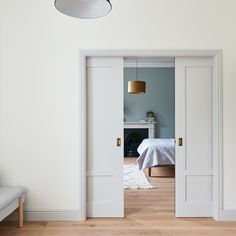 The pocket doors move in unison for ease of use, dividing the bedroom from the large master ensuite and walk in dressing room. French Pocket Doors, Sliding Pocket Doors, Double Pocket Door, Bedroom With Ensuite, Large Bedroom, Master Bedroom, Bedroom Divider, Room Divider Doors, Double Doors Interior