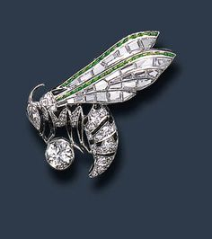 AN EXQUISITE DIAMOND, ONYX AND DEMANTOID GARNET WASP BROOCH, BY VAN CLEEF & ARPELS