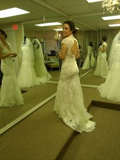 Peekaboo!    Bride Catherine pictured in: Allure Bridal