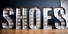 Polished Stainless Steel Built Up Letters 'SHOES' With LED Carnival Style Bulbs